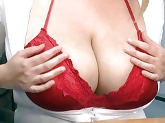 Titty racked blonde secretary shows her assets