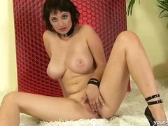 Busty gal enjoying herself