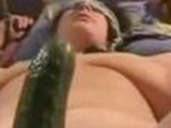 Cucumber slips in pussy