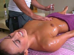 Tanned brunette Breanne Benson gets her body oiled and professionally massage by hawt guy