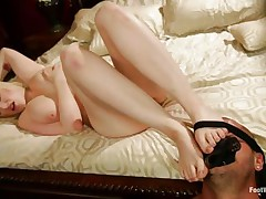 breasty milky white blonde rubbing a hard cock with her feet