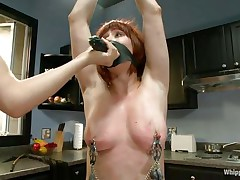 milfs teaching a redhead how to behave in the kitchen