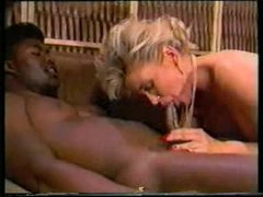 Two darksome guys fuck white wench in classic video